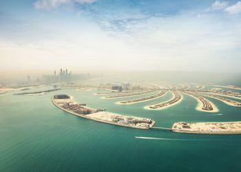 Dubai Marina skyscrapers and The Palm Island aerial view