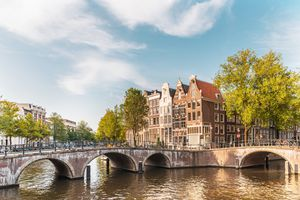Lovely canal houses and arched bridges in the center of Amsterdam.