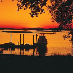 Silhouette of Dock with Boat at Sunset on Hilton Head Island