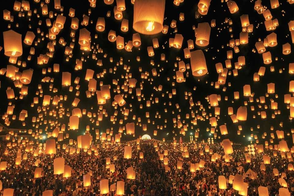 Sky lanterns being launched during Yi Peng and Loi Krathong in Thailand