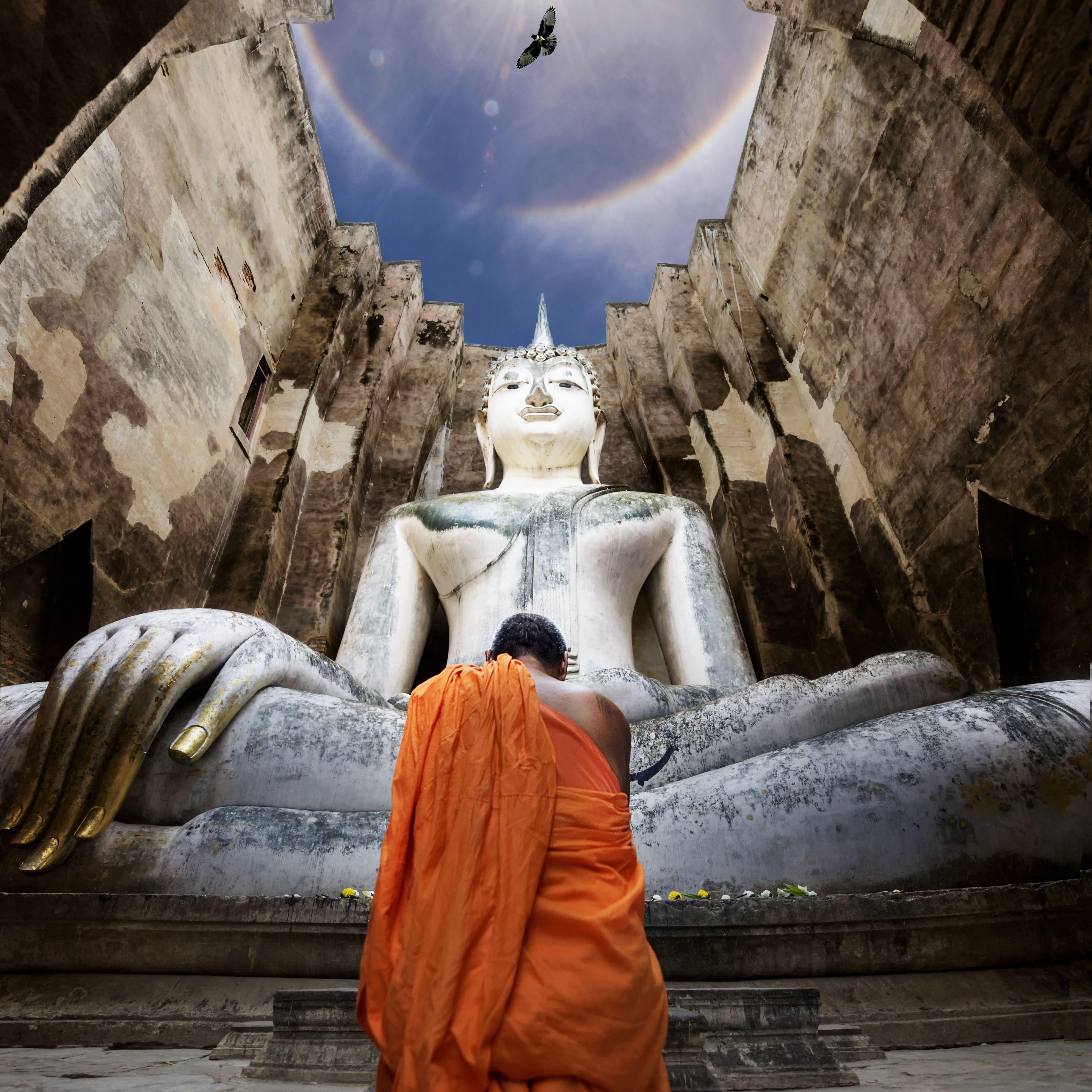 Buddhist monk worshipping in Thailand
