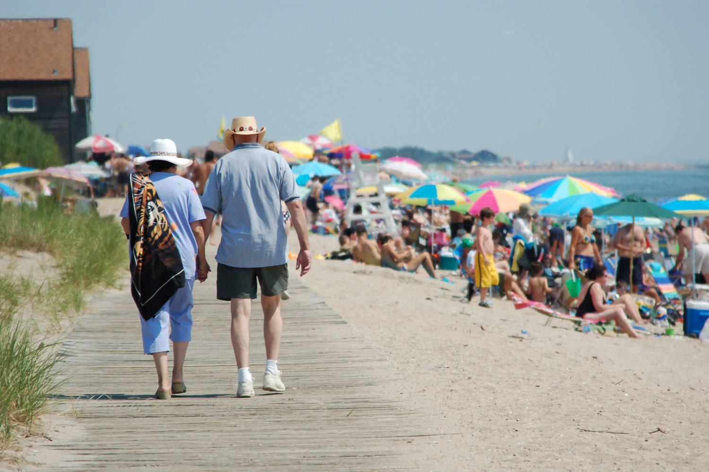 Couple walking on the Hammonasset Beach Boardwalk