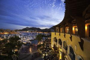 Restaurants, shops, and many boats at the Marina in Cabo San Lucas at dusk