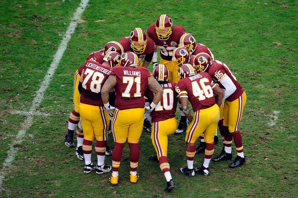 Washington Redskins huddle
