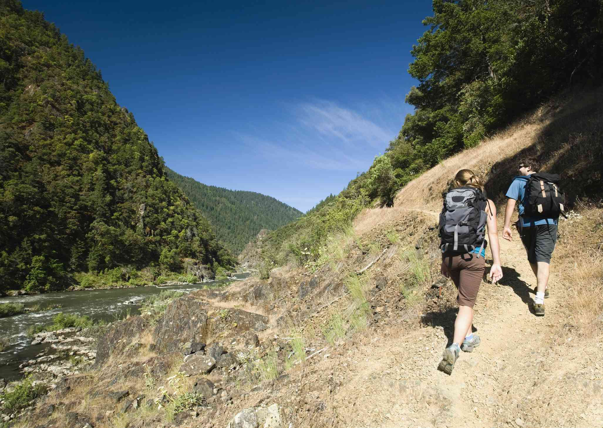 Hikers walking on riverside trail
