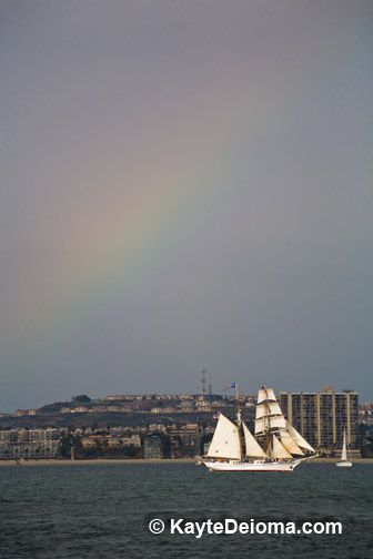 Rainbow over the brigantine Irving Johnson, a flagship of the Los Angeles Maritime Institute, seen from the Hawaiian Chieftain off the coast of Long Beach, CA