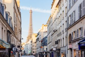 Street and Eiffel Tower on a sunny morning, Paris, France