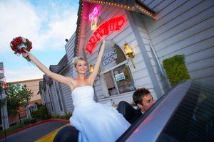 Wedding bride celebrating in convertible