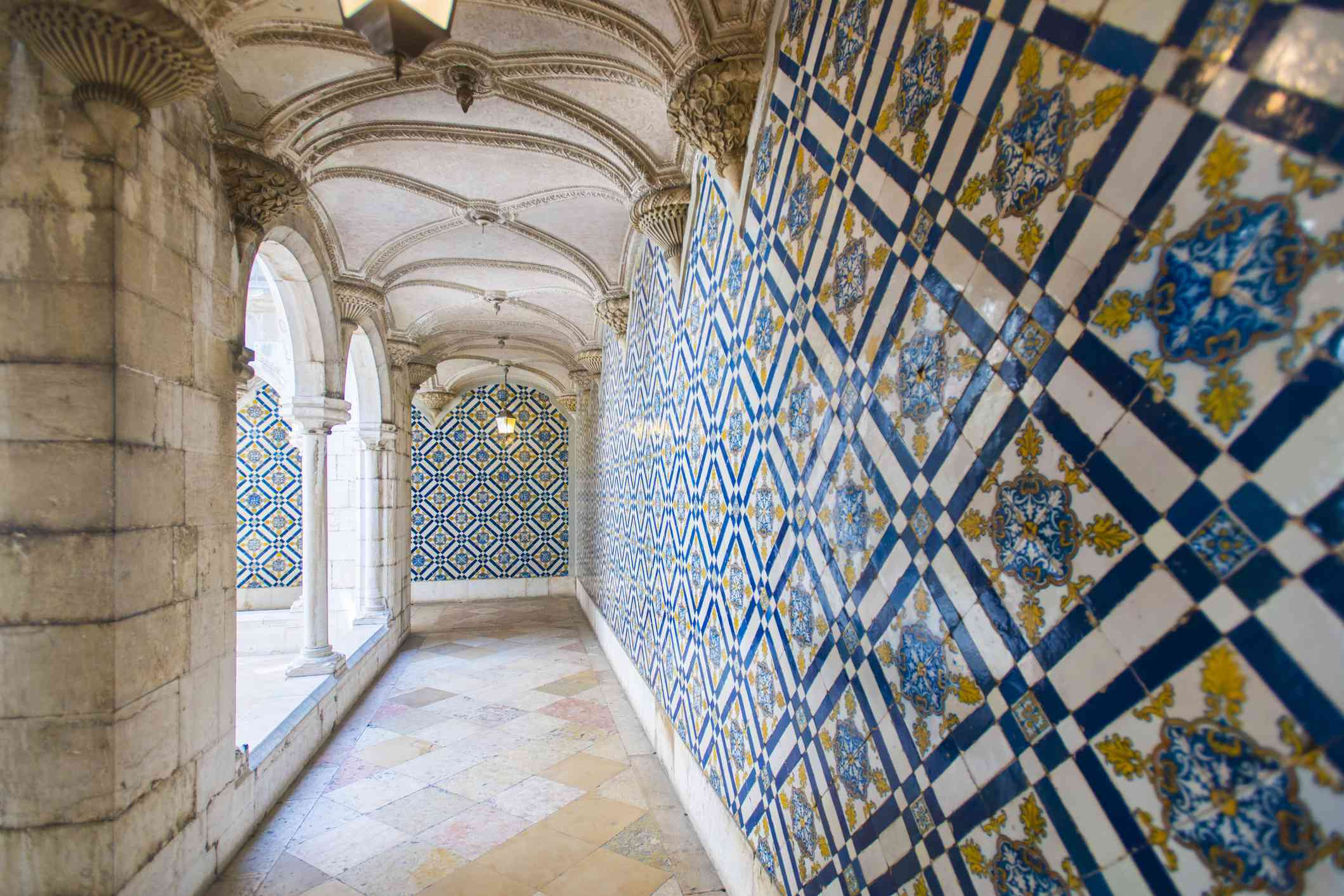 Walls covered in beautuful Azelejo tiles on display at The National Azulejo Museum in Lisbon, Portugal