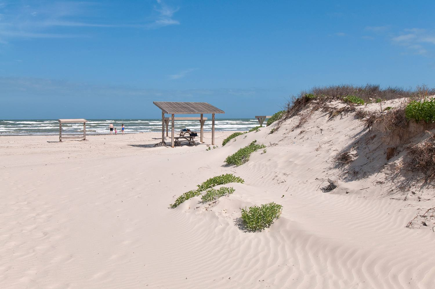 Family consisting of mother, father and female child at Malaquite Beach, Padre Island National Seashore.