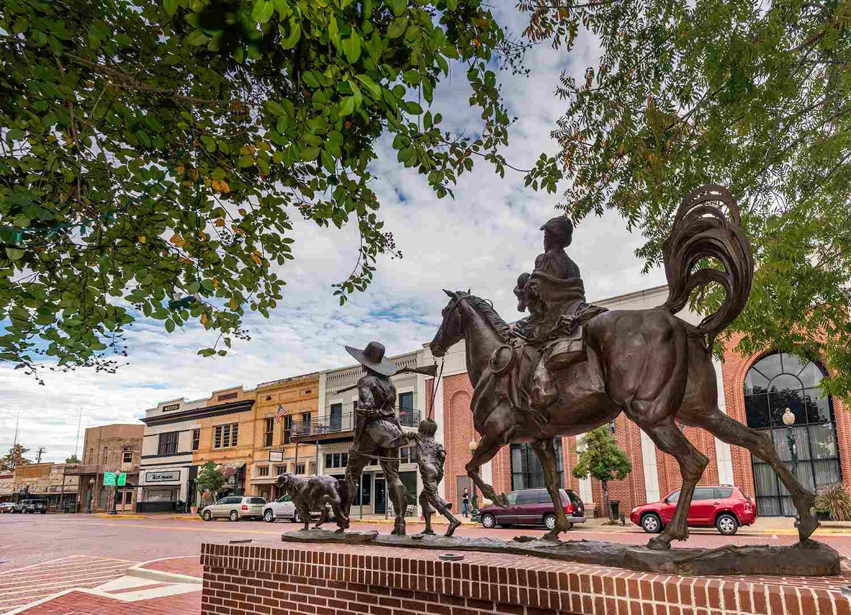 The Gateway, sculpture by Michael Boyett, on Main Street in Nacogdoches, Texas, USA