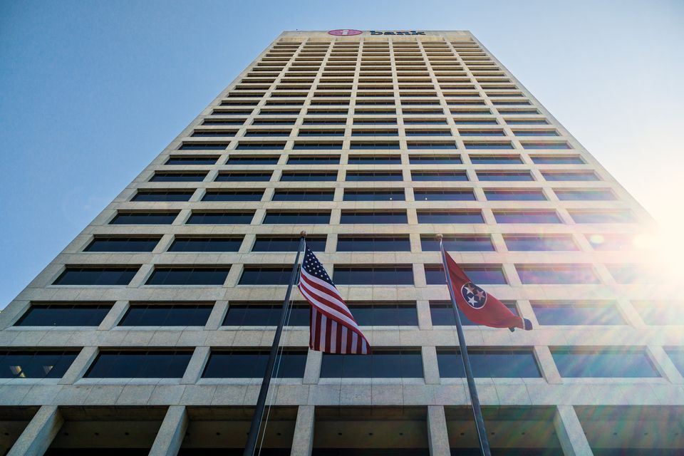 American and Tennessee flags in front of One Commerce Square, aka