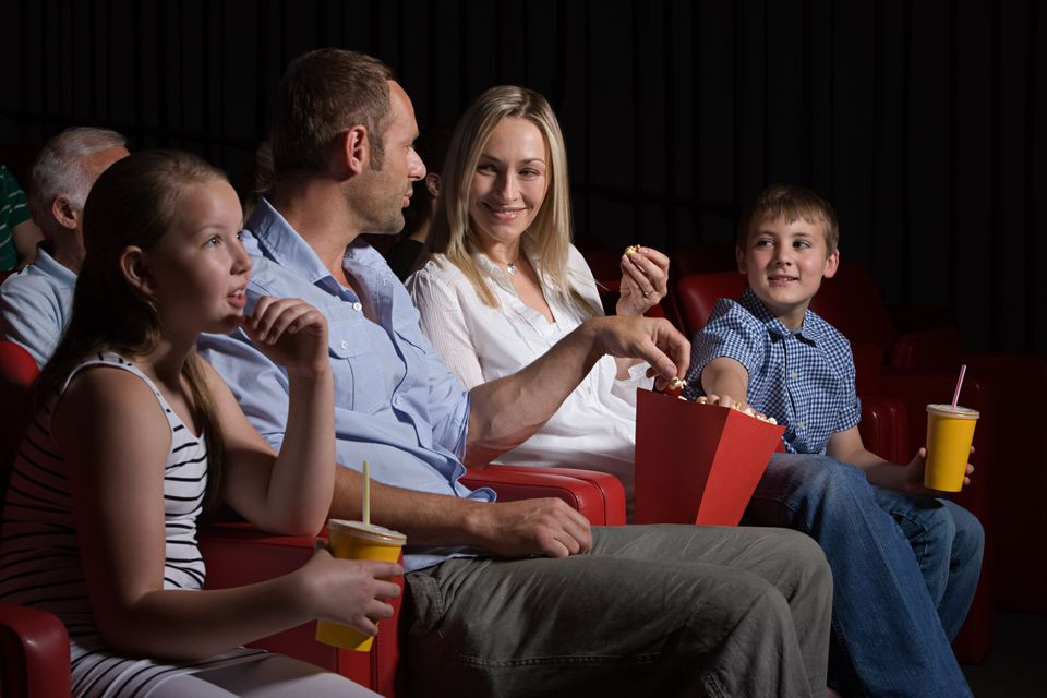 Family watching a movie.
