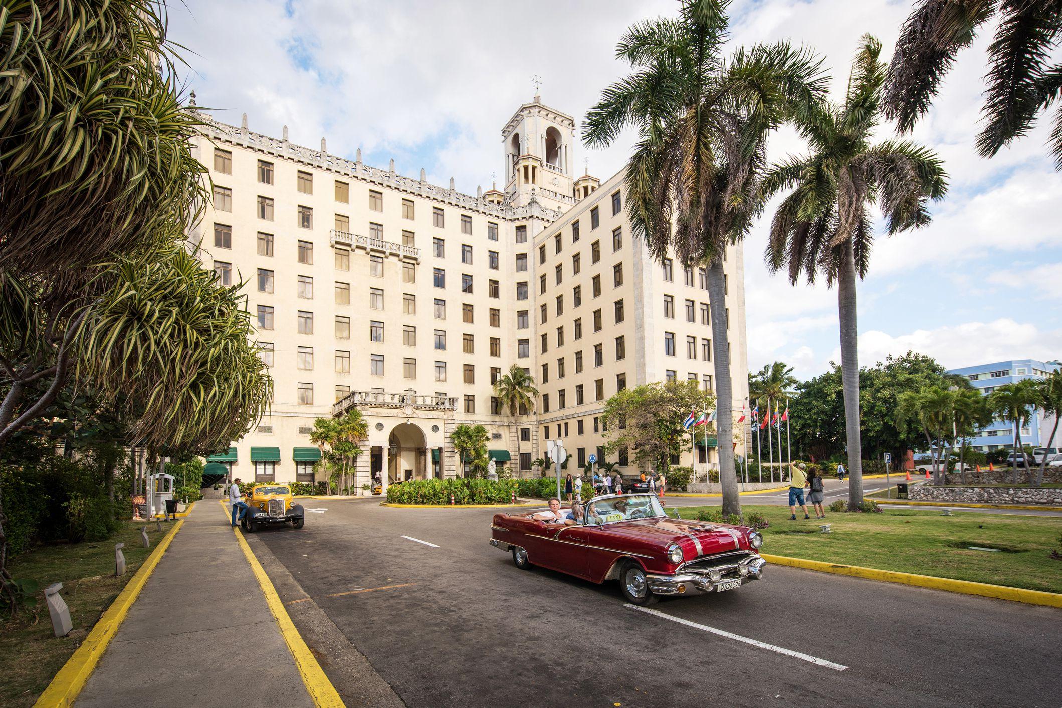 Vintage convertible car in front of hotel nacional in Havana, Cuba