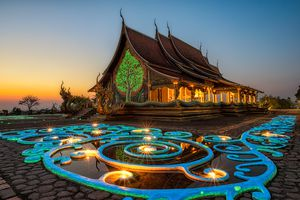 A colorful temple in Thailand at sunset
