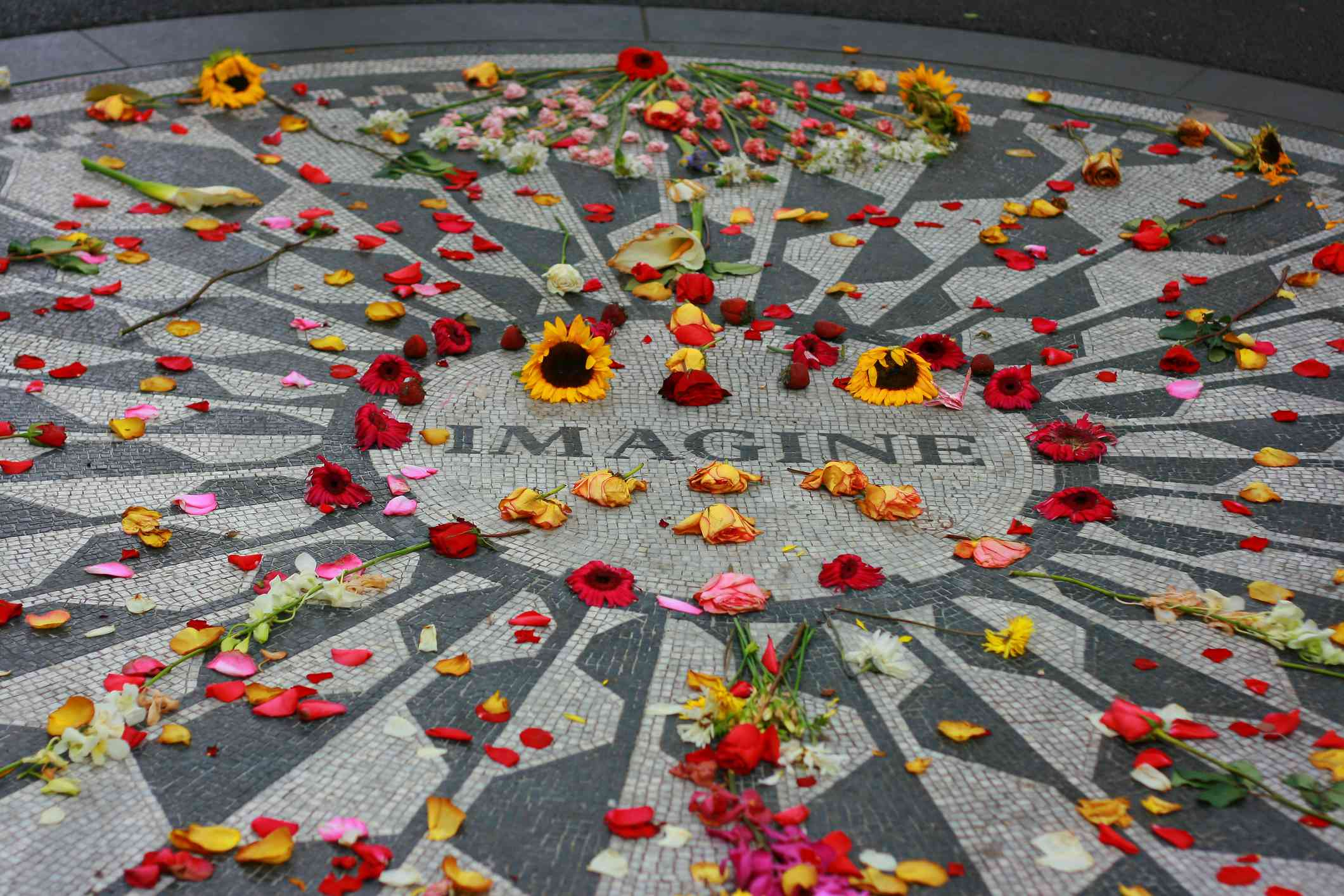 Strawberry fields John Lennon memorial tribute in central park, Manhattan with flowers spread around it