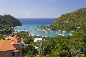 View over the sheltered harbour from verdant hillside above the village, Marigot Bay, St Lucia