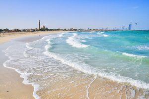 Dubai beach with city skyline in backfround