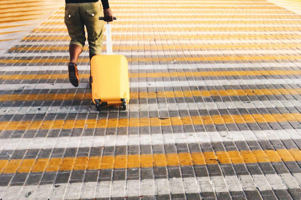 traveler wheeling luggage