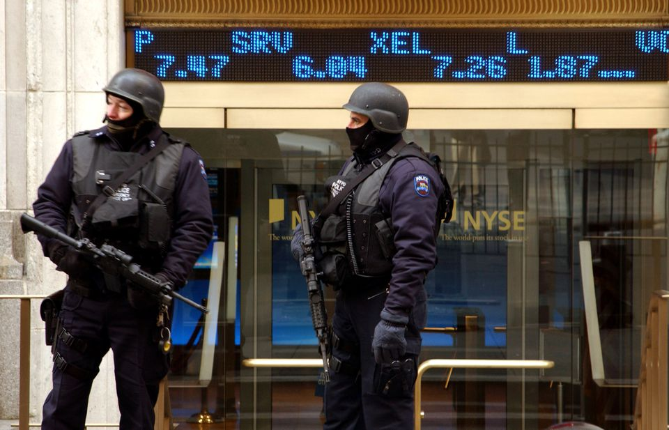 Armed police members in front of the New York Stock Exchange