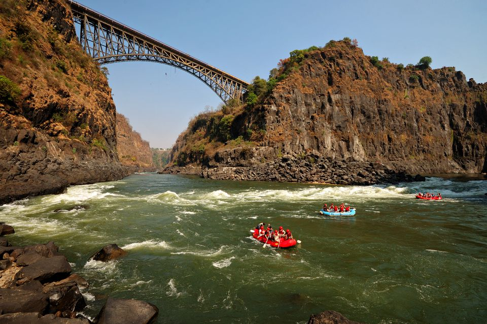 White water rafters at the beginning of the Zambezi River route near Victoria Falls Bridge