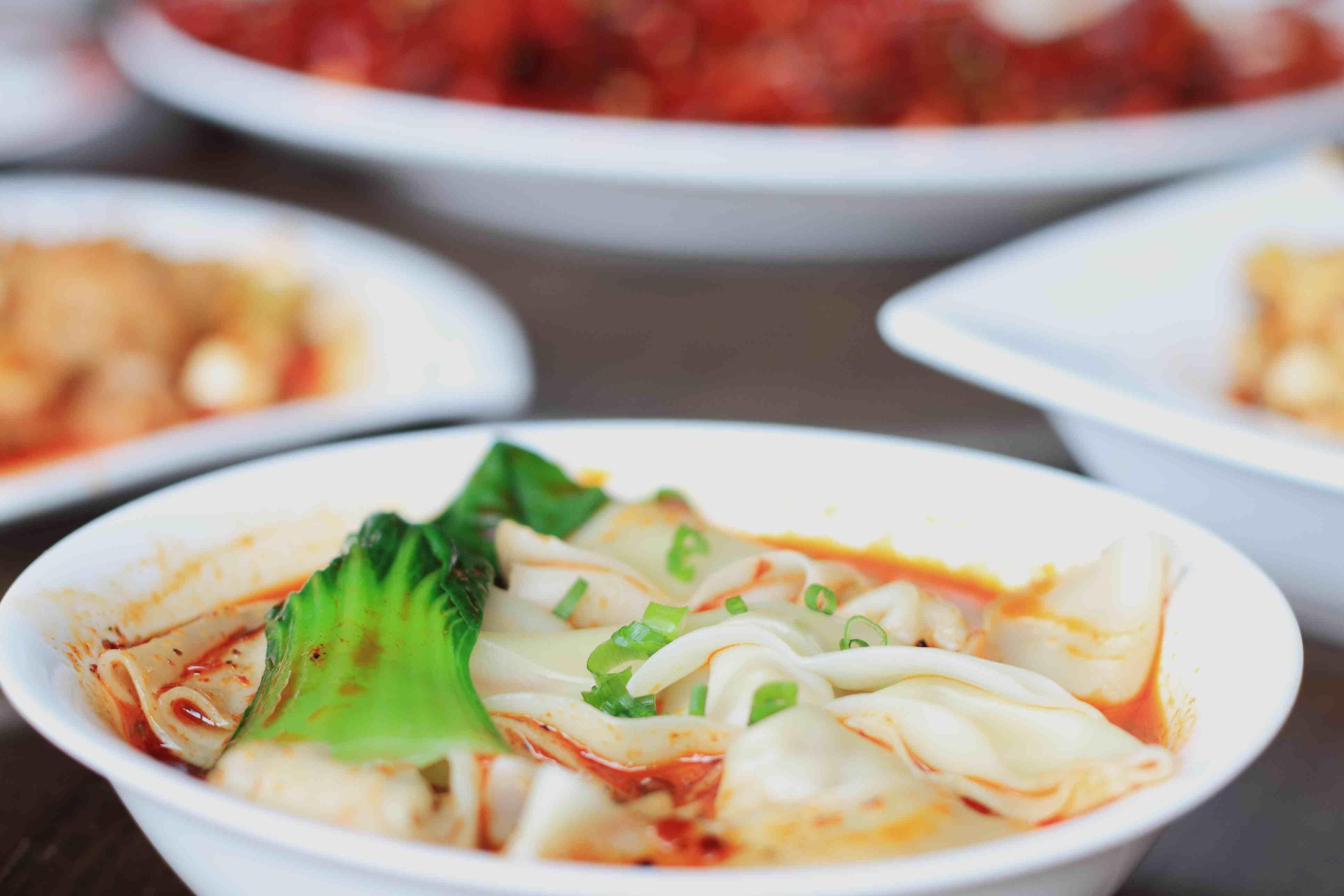Bowl of szechuan dumplings soup