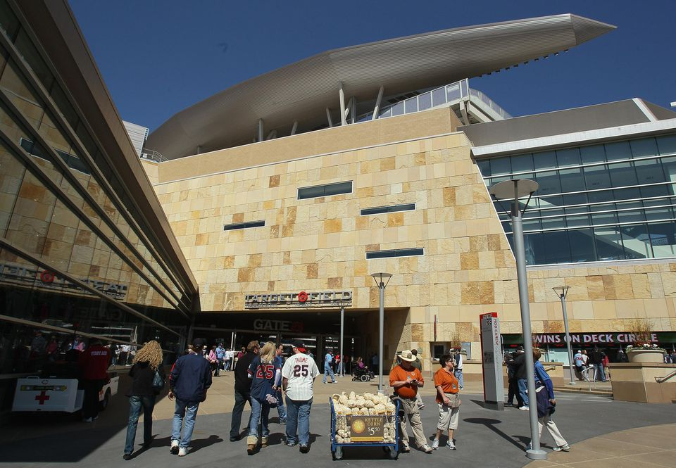 Fans enter the stadium before the game between the Oakland Athletics and the Minnesota Twins during Opening Day on April 8, 2011 at Target Field in Minneapolis, Minnesota.