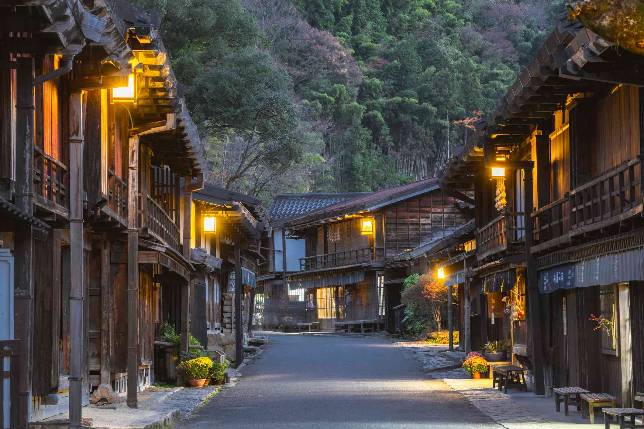 wide street with traditional two-level japanese buildings photgraphed at dusk