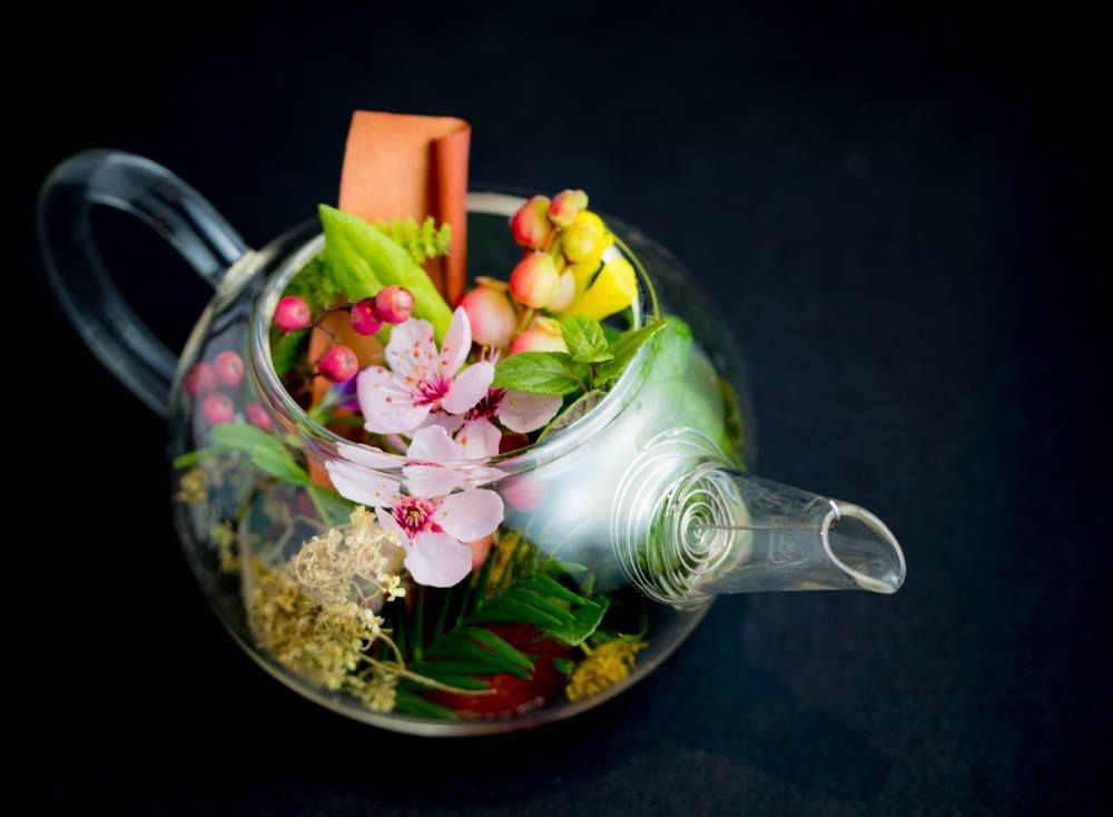 Tea pot filled with flowers