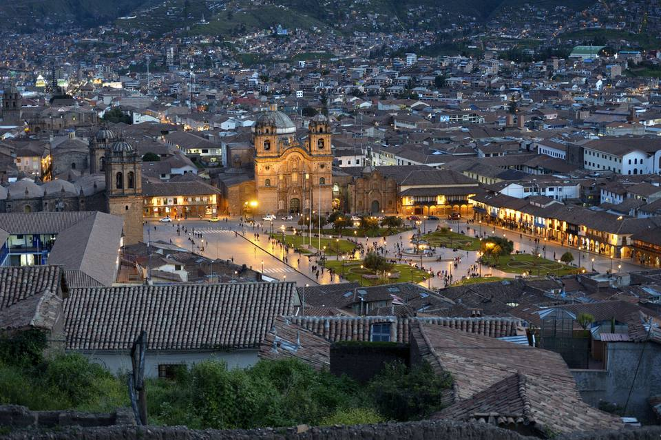 Peru, Cusco, cityscape with illuminated Plaza de Armas at night