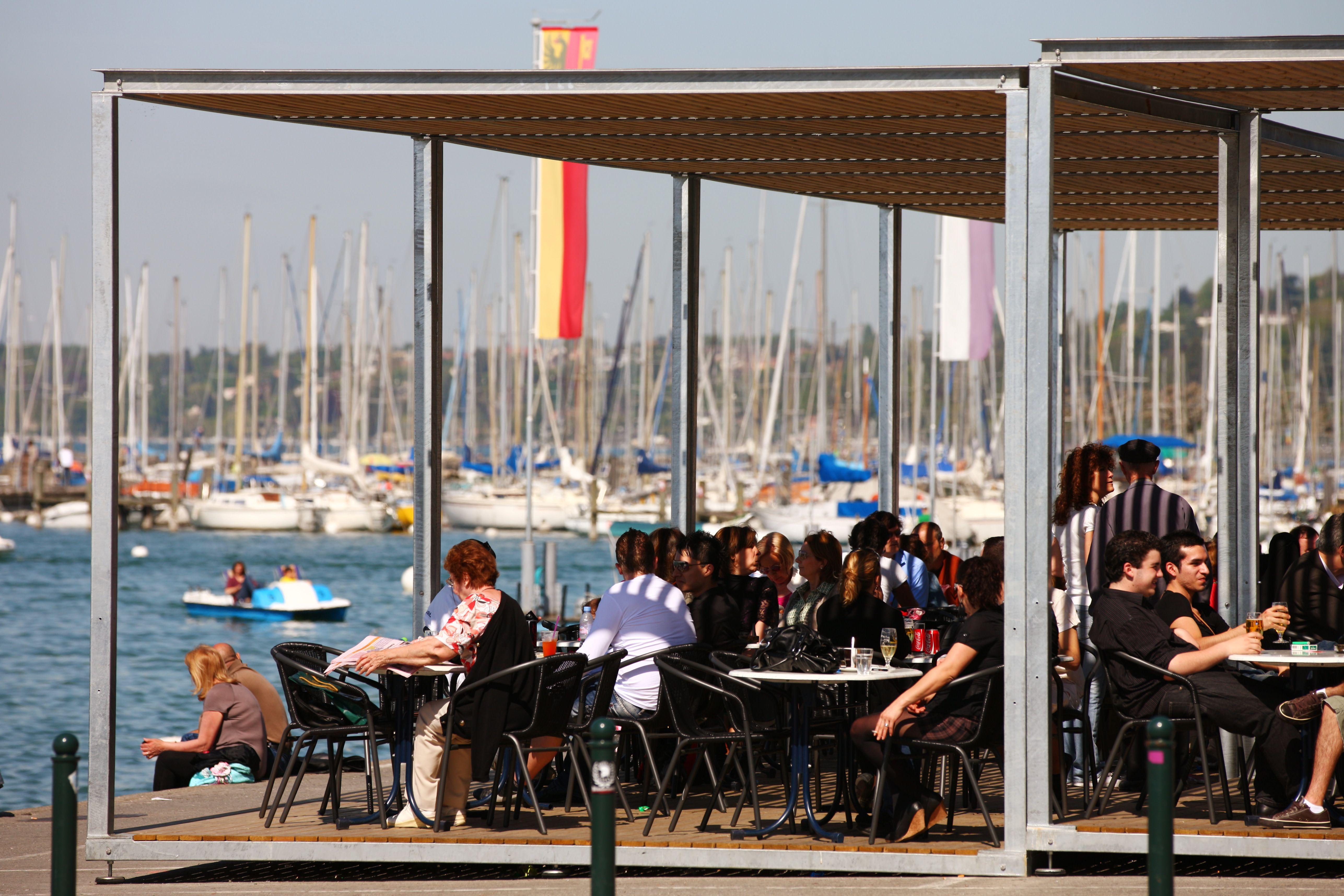 Patrons along the waterfront enjoying Wi-Fi in Geneva