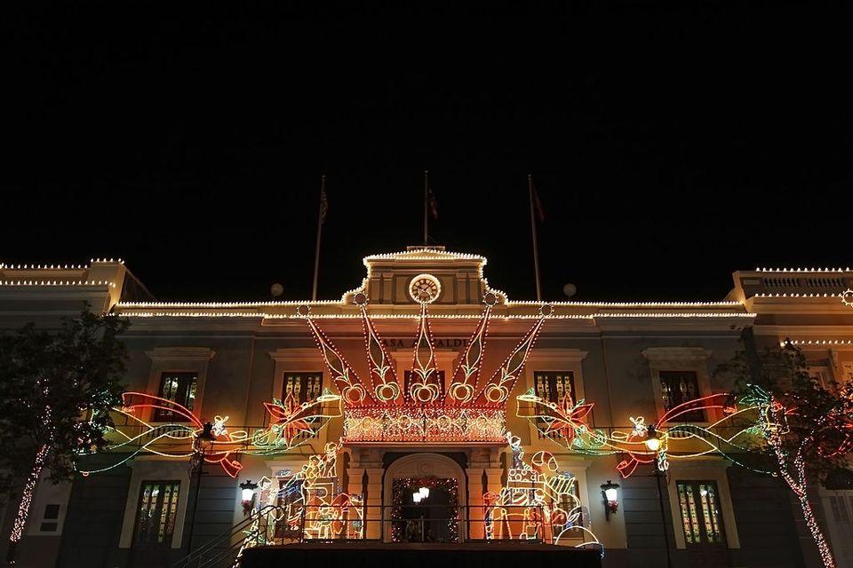 city hall lit up with christmas lights