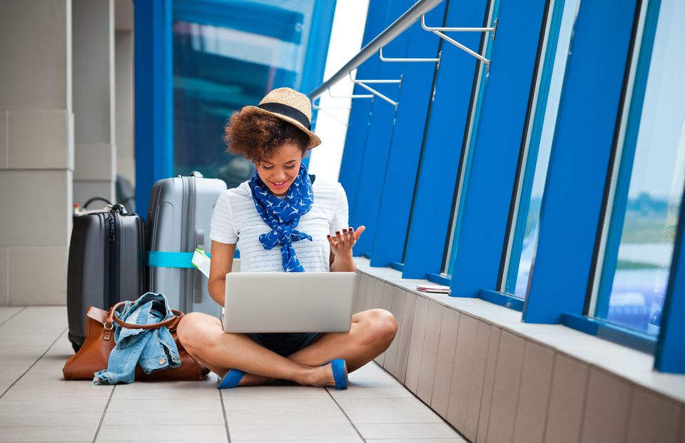 girl booking travel with discount card