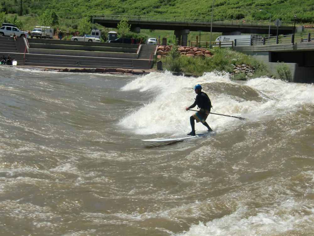 Stand Up Paddleboard Surfing at the Whitewater River Park. Photo © Teresa Plowright.
