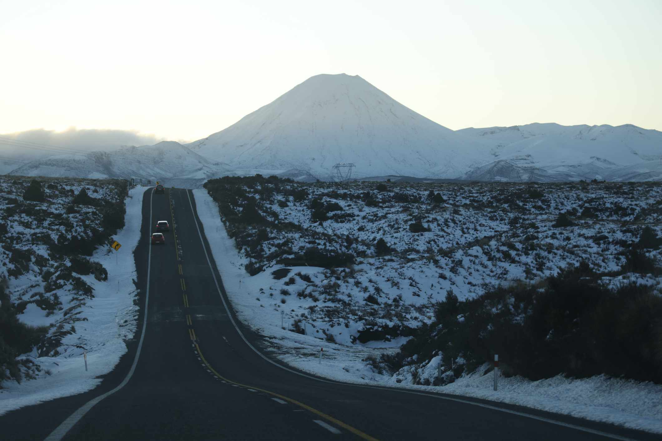 road leading to snow-covered volcano
