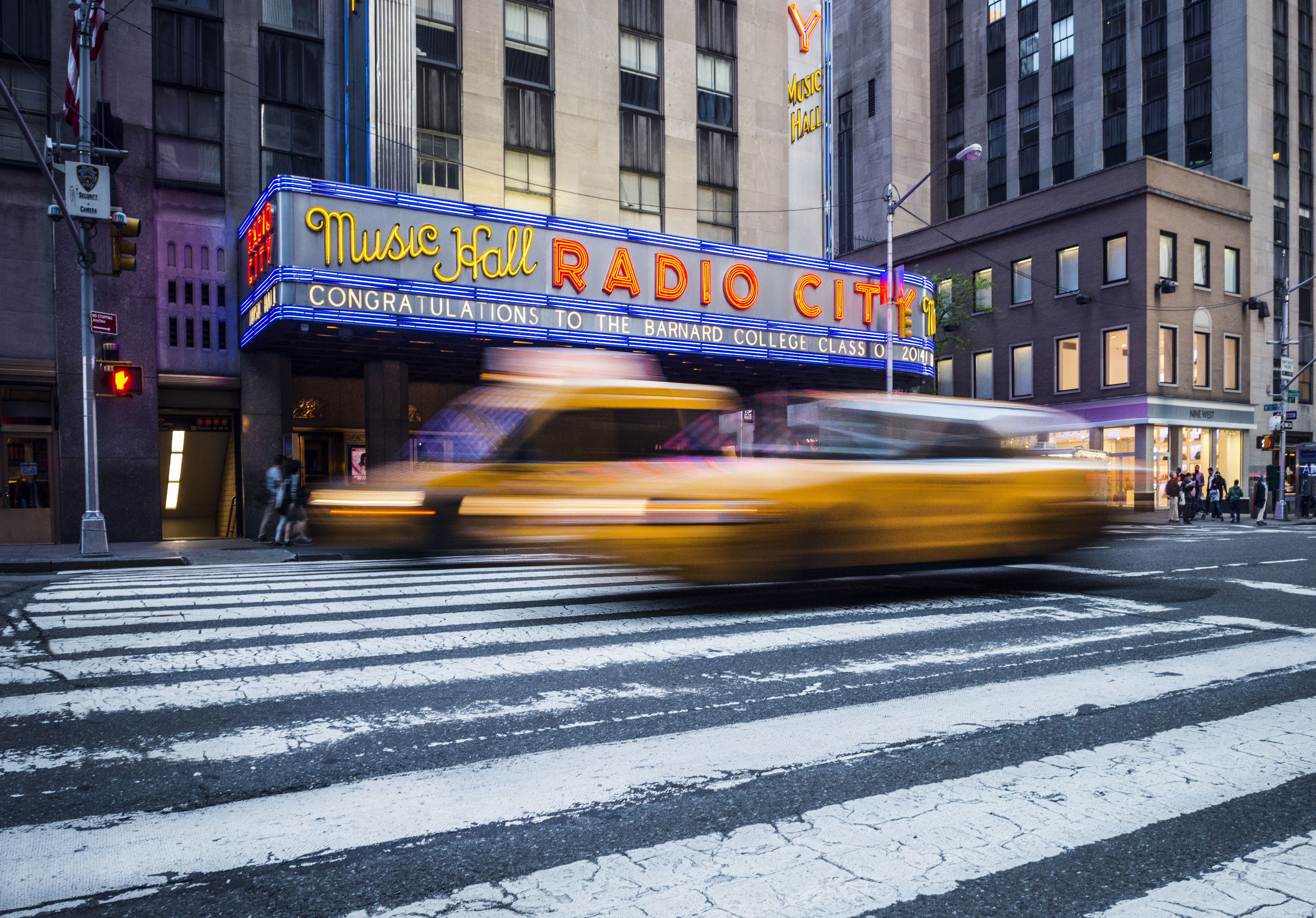 Radio City Music Hall And Yellow Taxis