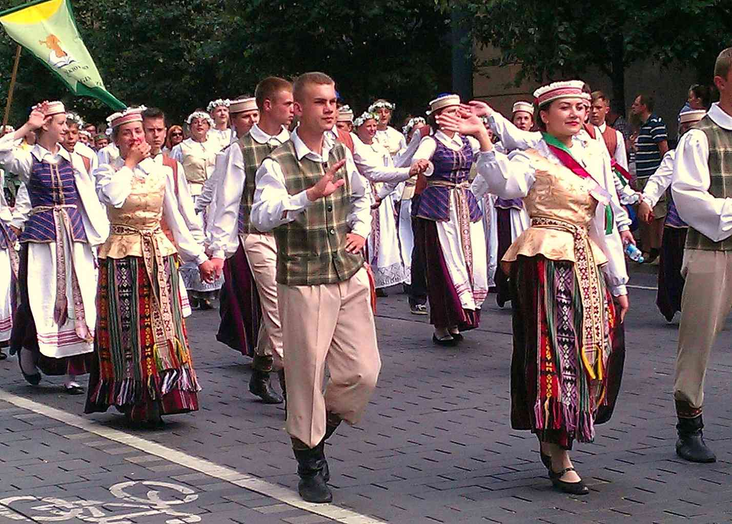 Lithuanians perform a ceremony in traditional dress