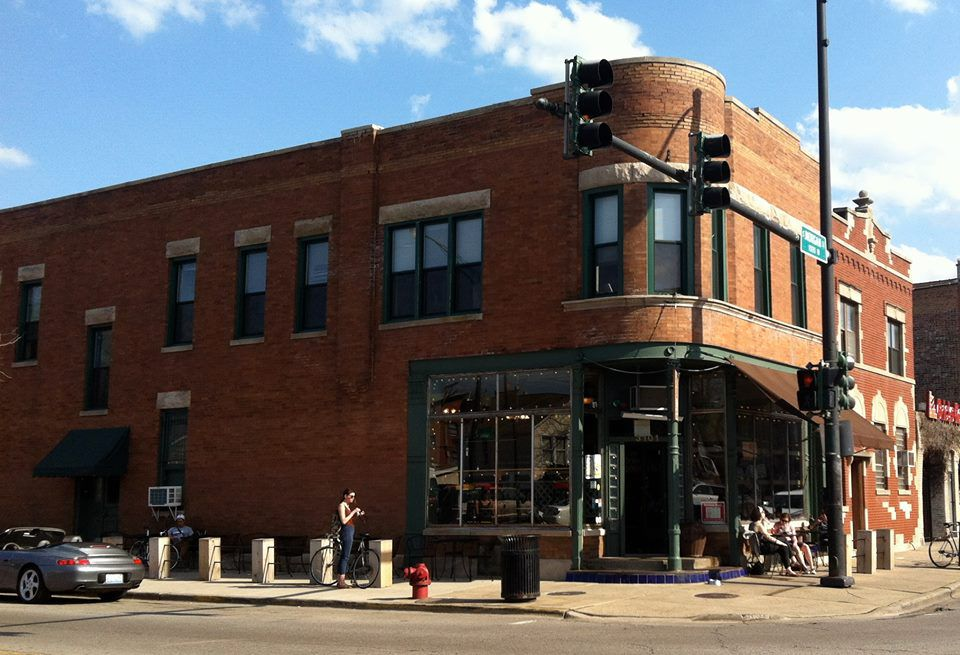 Exterior of brown-brick building that houses the Bridgeport coffee house