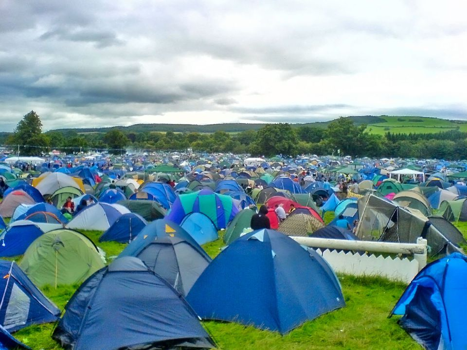 a multitude of tents on a sprawling lawn