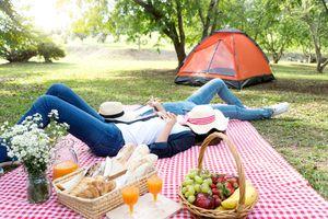 People sleeping on camping blanket