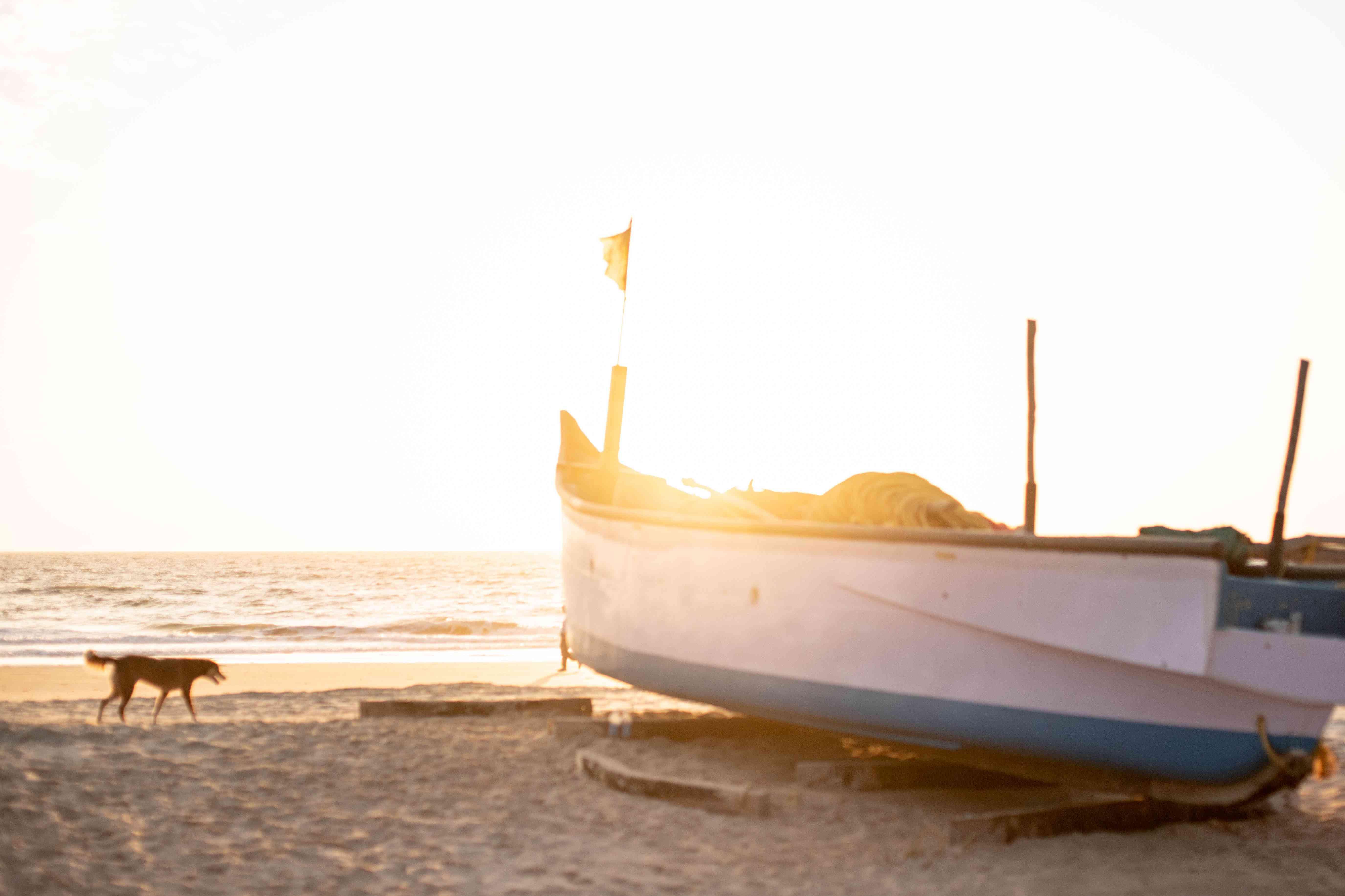 A canoe on Arambol Beach during sunset