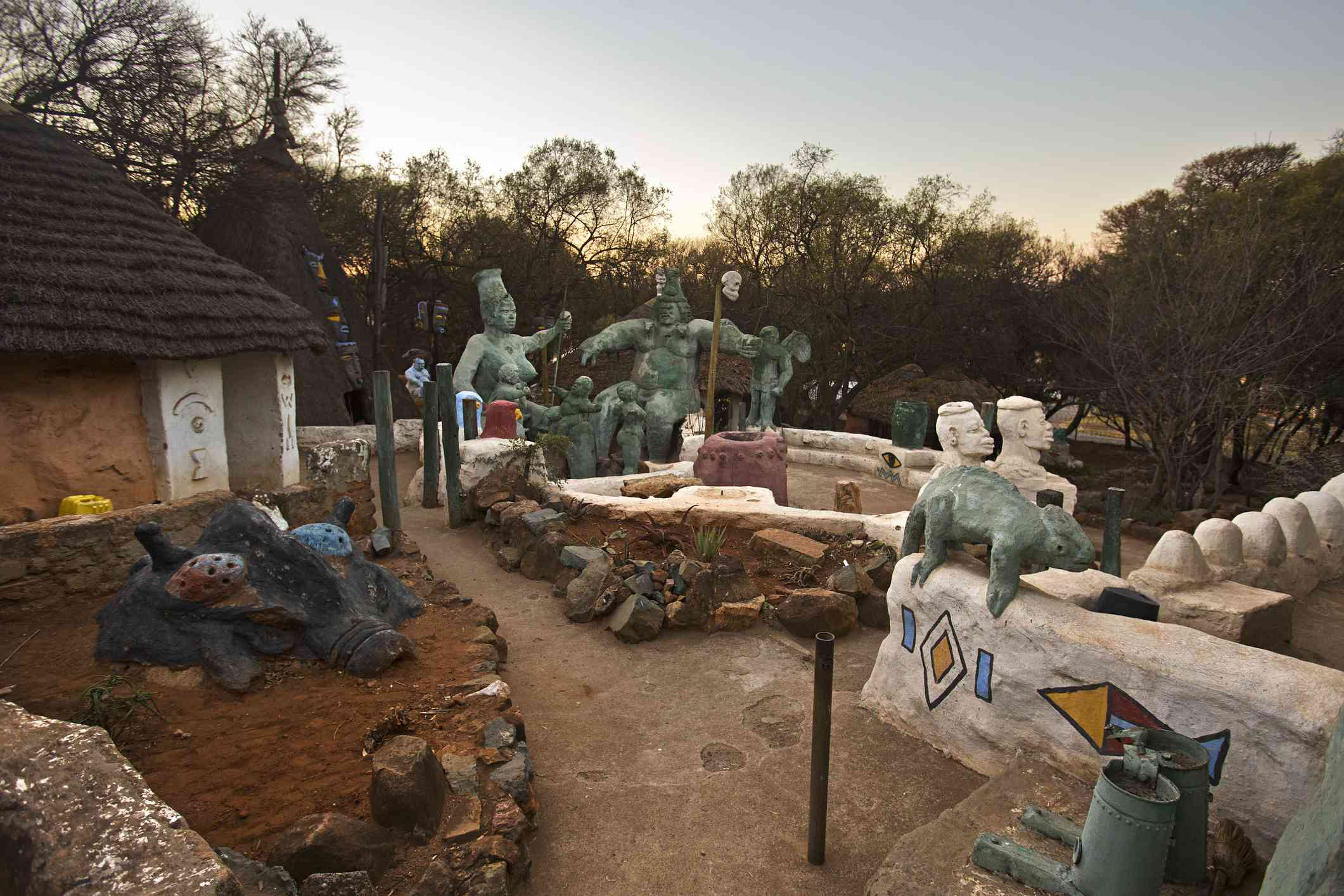 Sculptures in Credo Mutwa Cultural Village in Soweto at sunset