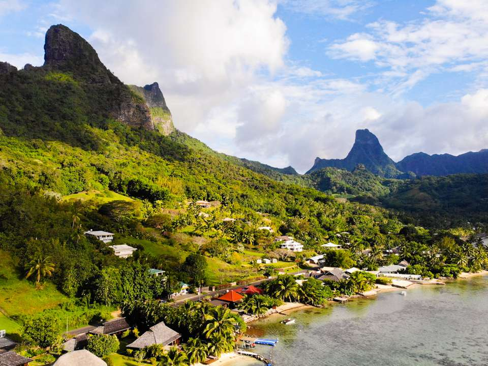 A wide view of beaches under the mountains of Moorea