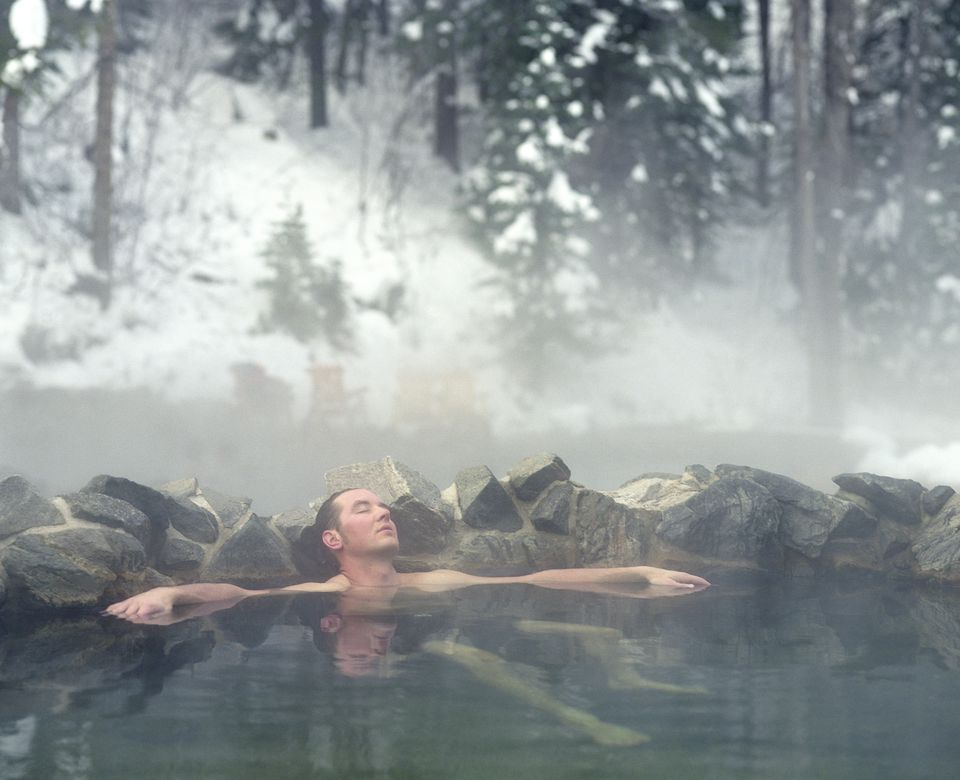 Man relaxing in Strawberry Park Hot Springs