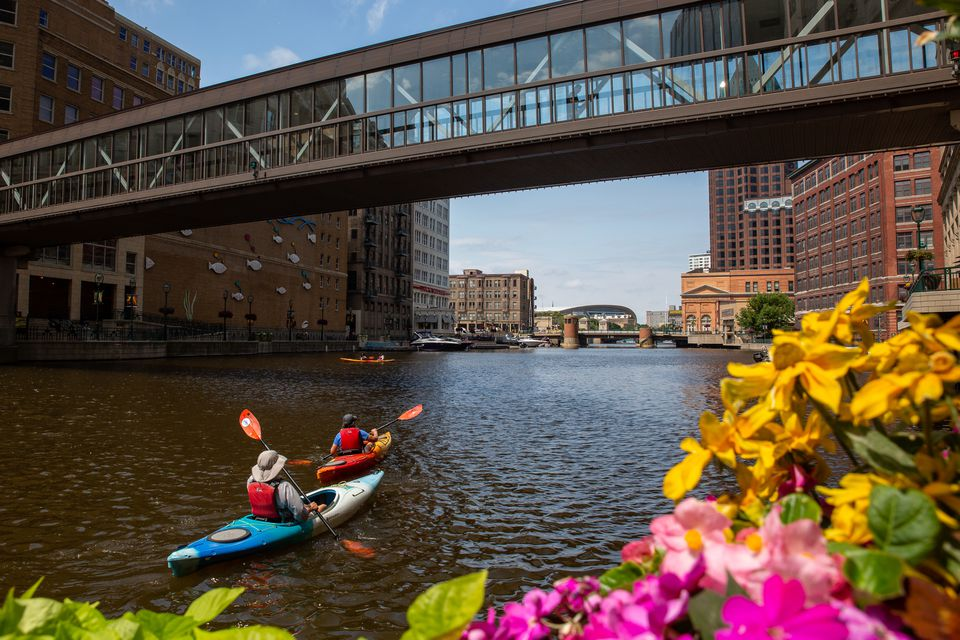 People kayaking down the Milwaukee River
