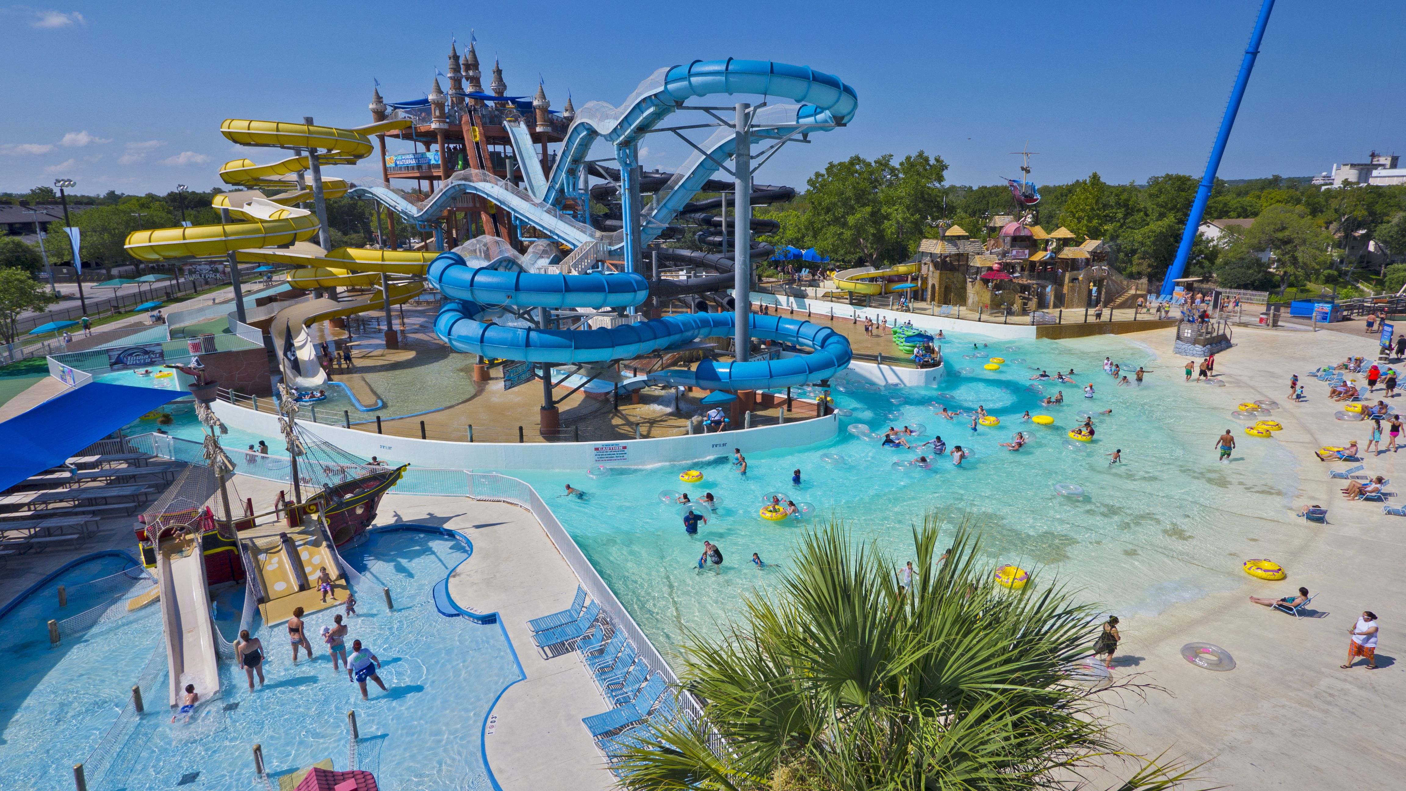 High angle view of water slides, pirate ship kid area, and wading pool