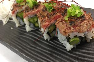 seared Wagyu beef sushi roll with asparagus, scallions and shredded chili