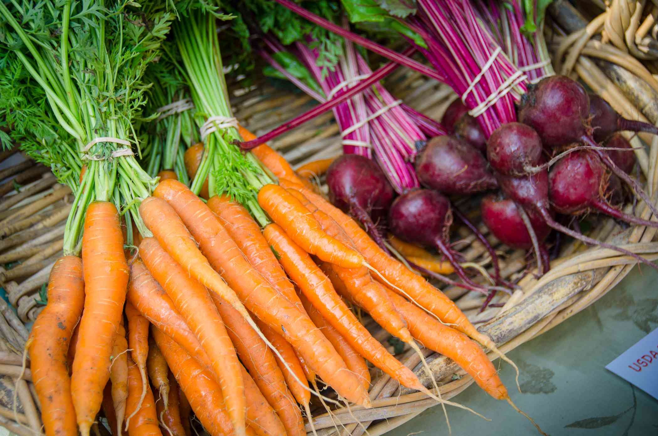 Carrots and beets on straw basket