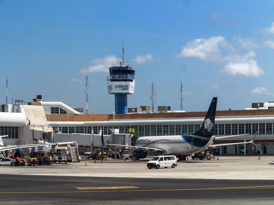 Airport tower and gates in Cancun