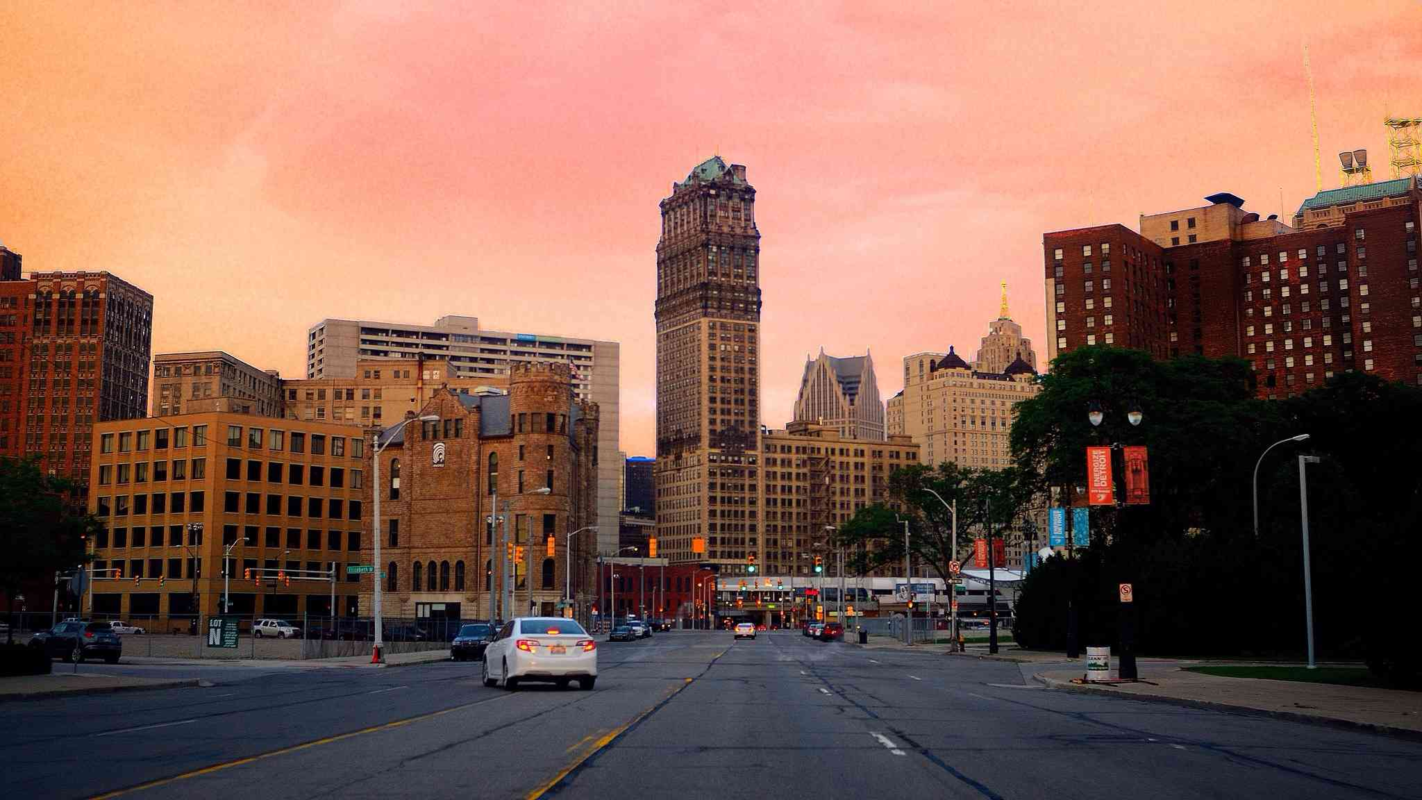 Street And Cityscape Against Sky During Sunset